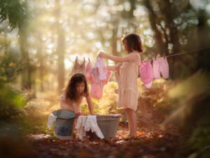 Canon fine art fall portrait of two little girls doing the laundry in an autumn forest just like in the old days by Willie Kers copy