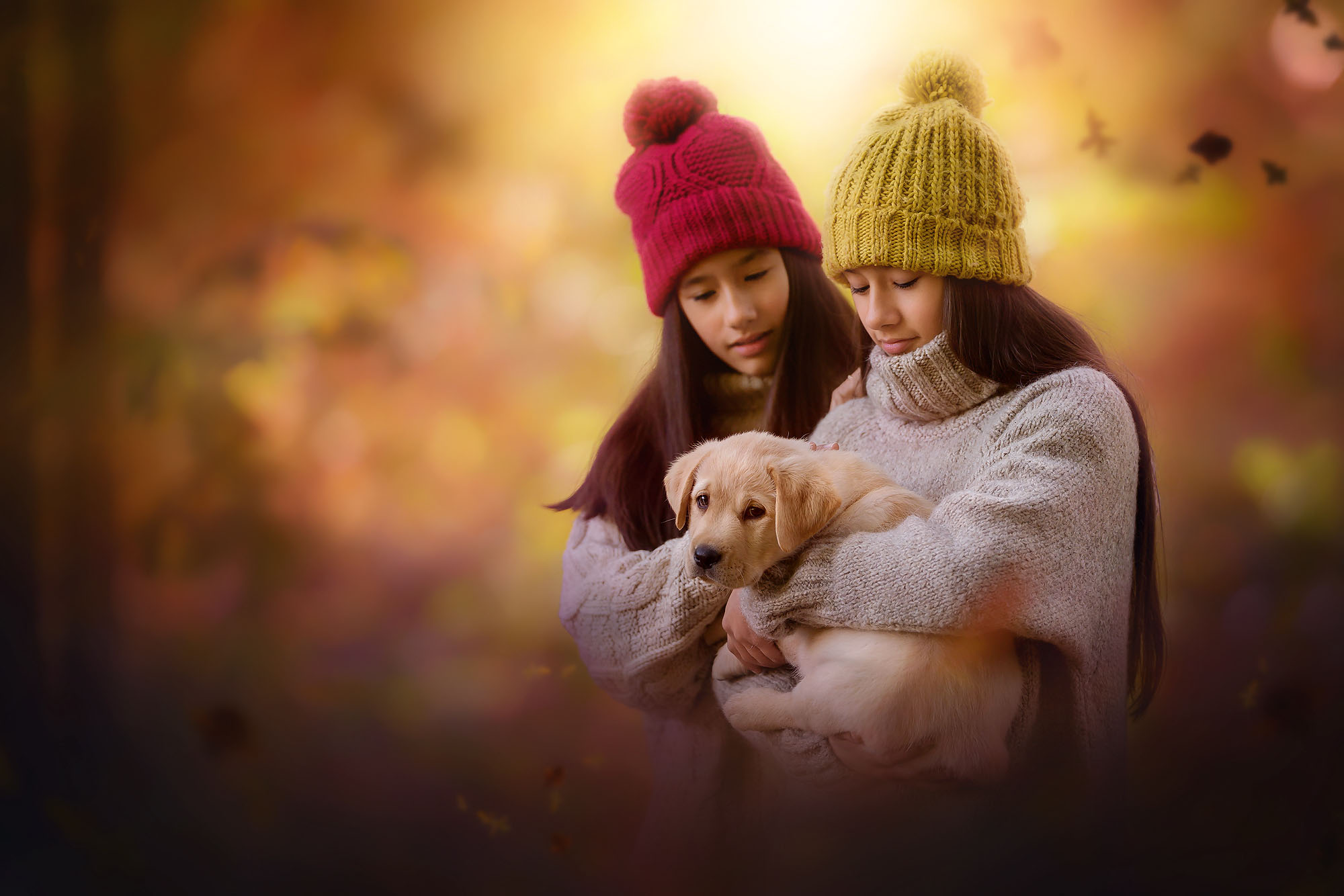 Canon 5d mark III portrait of two gorgeous asian girls holding a puppy in an enchanted autumn forest by Willie kers copy