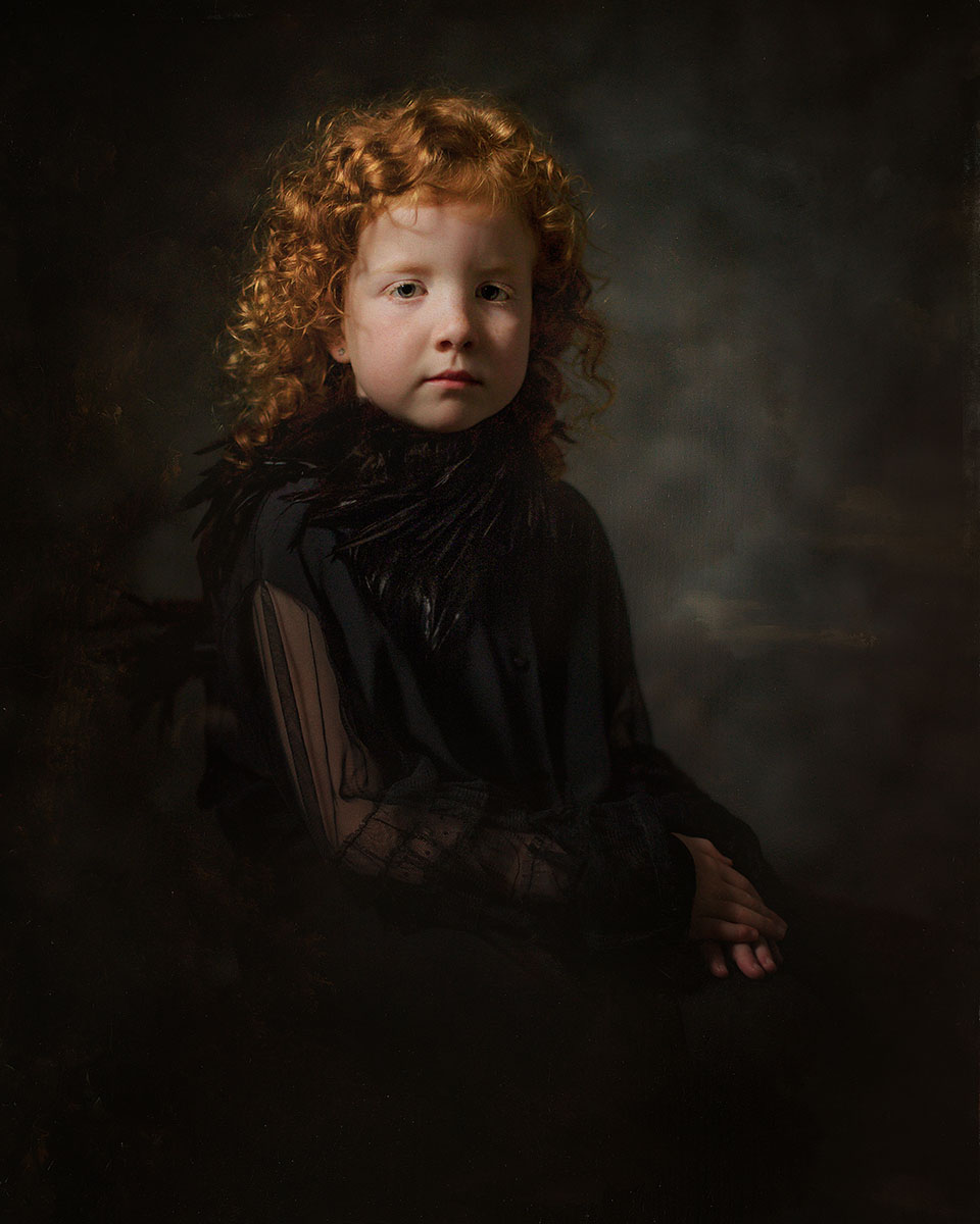 Canon fine art Portrait of a young curly red child photographed in the spirit of Rembrandt van Rhijn and with a sky of Gerard Dou by Willie Kers from Apeldoorn