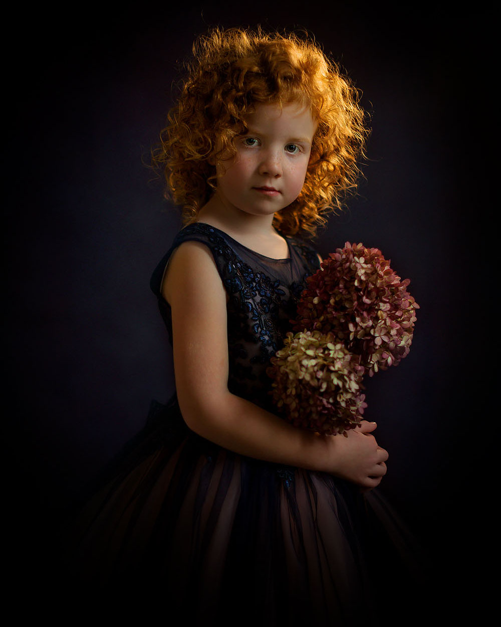 Canon mirrorless EOS R Fine art portrait of a little young curly red head girl with flowers in her hand standing in a blue wedding dress like Rembrandt by Willie Kers copy