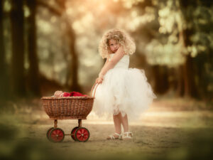 Canon EOS R fine art child portrait of a blonde little curly girl with a doll and her stroller by Dutch photographer Willie Kers